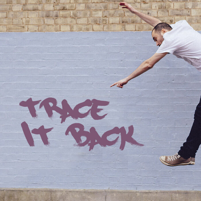 Jake leaps in front of a wall for the single artwork for Trace It Back